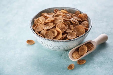 Whole grain cereal in a bowl on a blue background Reklamní fotografie