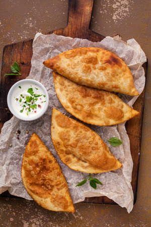 Traditional russian and caucasian pies - meat chebureks fried in oil. Zdjęcie Seryjne