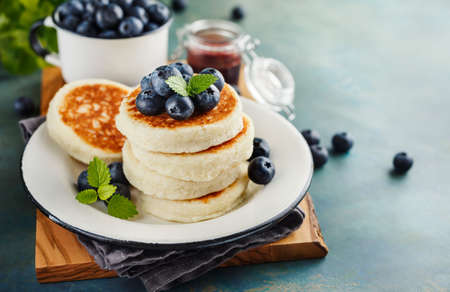 Cottage cheese pancakes with blueberries and mint, Healthy Breakfast. Stock Photo - 78285246