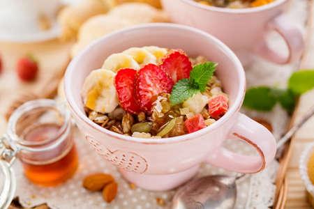 Delicious porridge with banana and strawberries. Closeup shot
