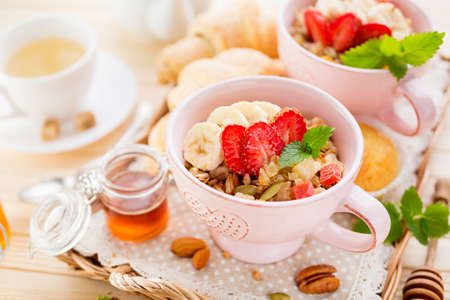 Porridge with banana and fresh berries. Healthy Breakfast Stock Photo