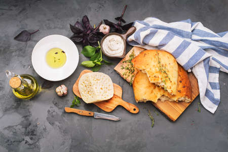 Traditional Italian Focaccia with herbs and cheese. Top view Stock fotó - 80233087