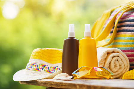 Sunscreen cosmetic and beach accessories Reklamní fotografie