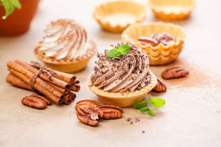 Delicious tartlets with whipped cream.