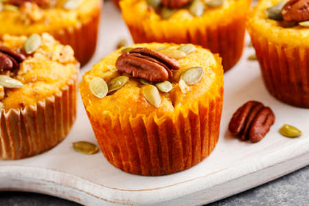 Homemade muffins of pumpkin with pecans. Close up Stock Photo