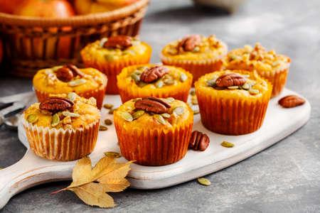 Homemade muffins of pumpkin with pecans. Autumn menu Stock Photo