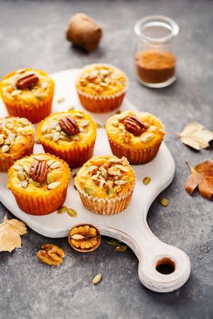 Freshly baked pumpkin muffins with pecans.