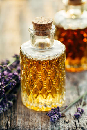 Lavender oil in bottles and fresh lavender. Shallow DOF