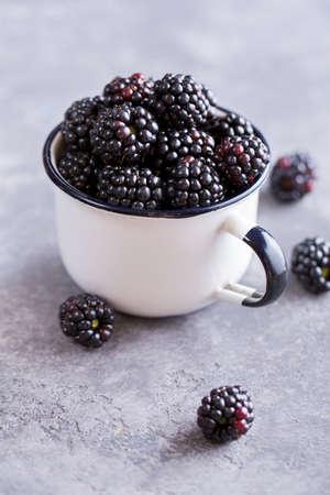 Juicy fresh blackberries in a cup. Organic healthy berries. Selective focus 写真素材