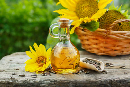 Organic sunflower oil in a small glass jar. Outdoors