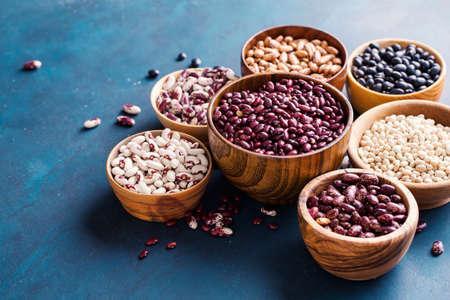 Assortment of beans on a blue background. Stock fotó