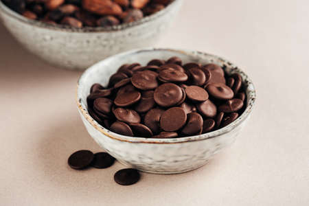 morsels: Dark chocolate in drops Stock Photo