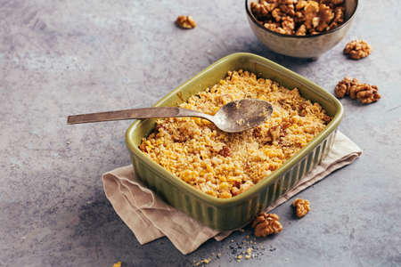 Apple and cranberry crumble with walnut