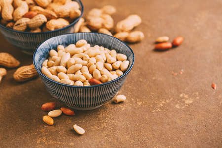 Peanuts in bowls wiht copy space. Toned image