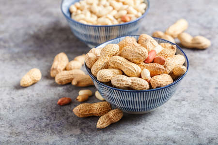 Raw peanuts in shells, selective focus