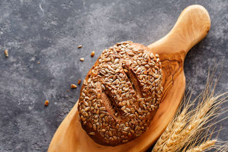 loaf of bread sprinkle with sunflower seeds. Healthy food