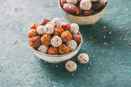 Healthy energy balls made of dried fruits and sesame.