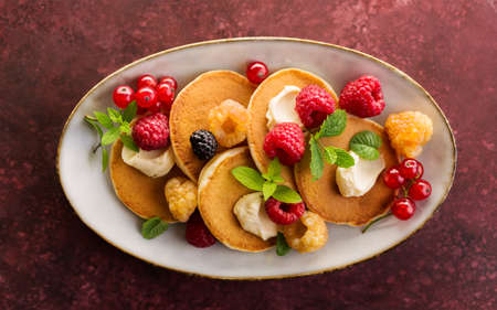 Sweet pancakes with raspberry and red currant. Top view.