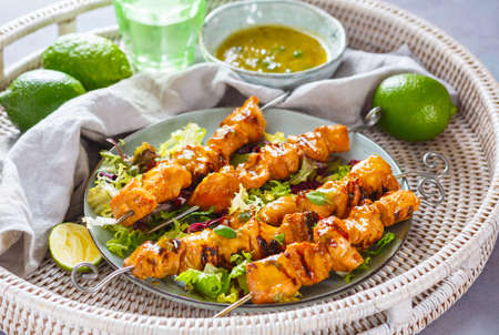 Chicken skewers with mint-lime dipping sauce. BBQ. Summer food. Stock Photo