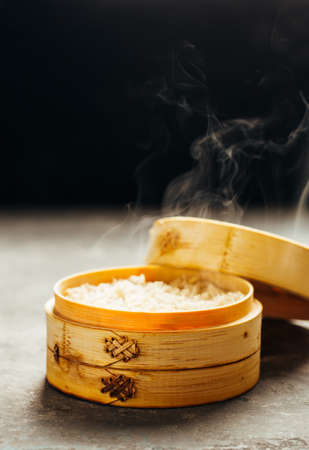 White rice in bamboo steamer with steam