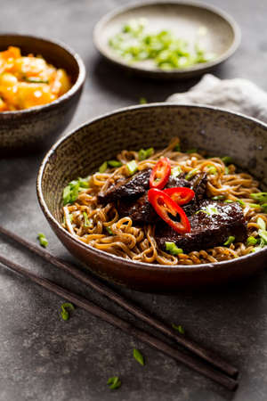 Soba noodles with beef and chopsticks