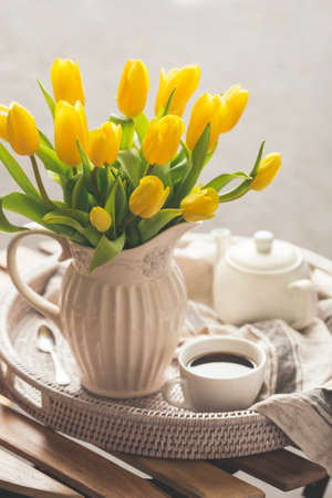 Yellow tulips and fresh tea Stock Photo