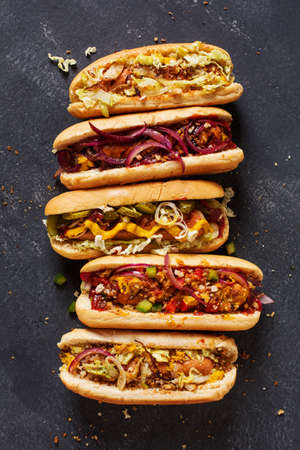 Homemade Hot Dogs on a dark background. Top view