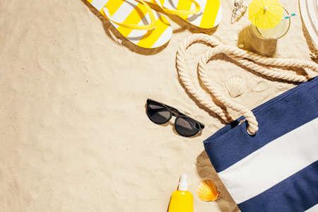 Beach accessories on the sand. Reklamní fotografie