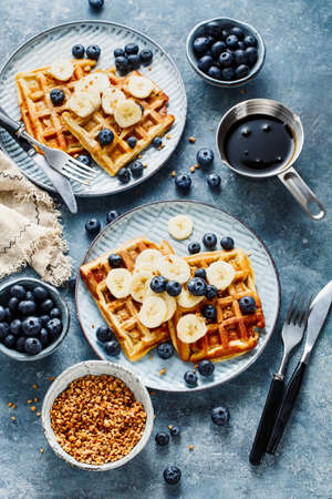 Waffles with banana and fresh blueberries. Tasty and healthy Breakfast Stock fotó