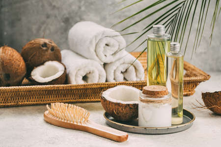 Natural coconut oil for body and hair care. Spa composition.