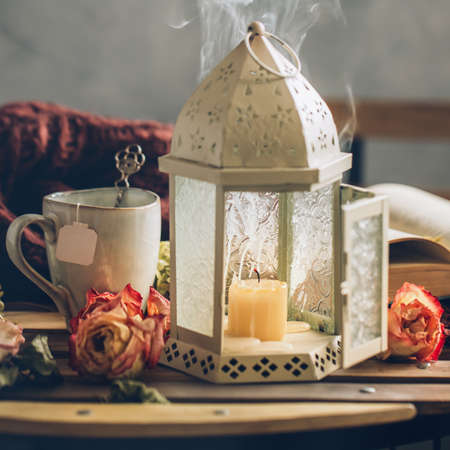 Vintage lamp with extinguished candle, autumn still life Stock Photo
