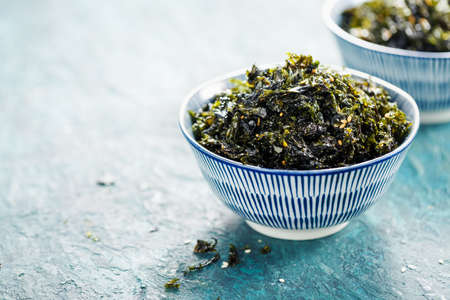 Healthy Japanese bowl of seaweed with sesame and sea salt. Food background with copy space.