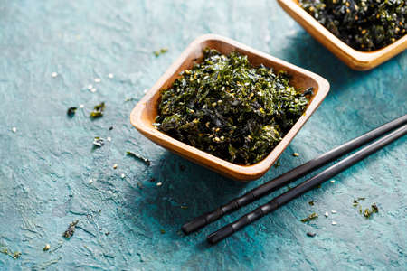 Healthy bowl of seaweed with sesame and sea salt. Food background with copy space. Asian cuisine Stock fotó