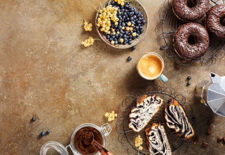 Delicious Breakfast with lots of sweet pastries and coffee. Top view. Food background with copy space.
