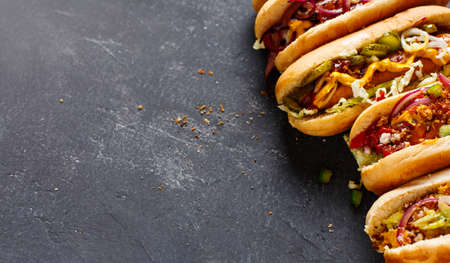 Different Hot dogs with a sausage on a fresh rolls. Food background with copy space