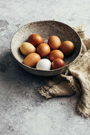 Fresh farm eggs in a bowl. Natural products, healthy food. Selective focus.
