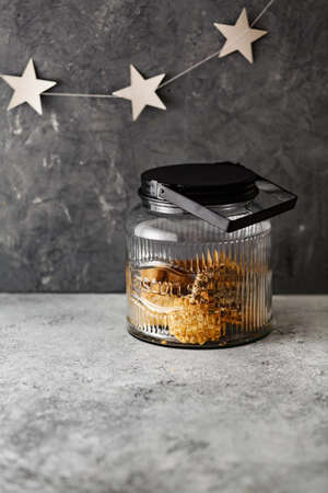 Large glass jar with cookies on the table. Stock Photo