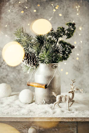 Vintage Christmas festive decoration, Snow-covered Christmas tree Branches,balls and reindeer. Stock Photo