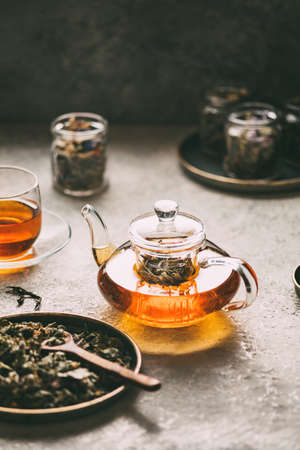 Glass teapot of freshly made herbal tea.