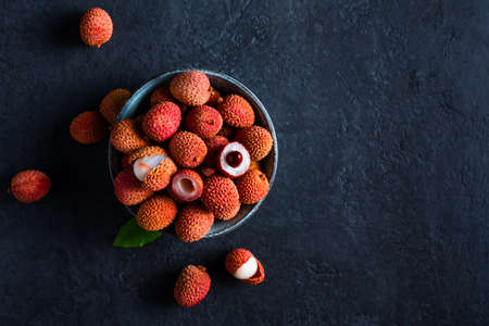 Fresh fruit Lychee on black background.