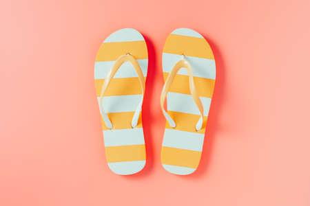 Flip flops on pink background Stock Photo - 117089307