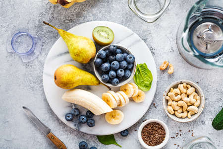Fresh fruit and blueberries for making smoothies, top view. Reklamní fotografie - 117089579