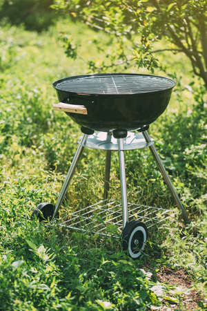 Empty grill with coal