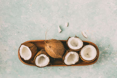 Fresh coconuts with coconut halves 스톡 콘텐츠