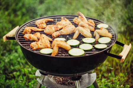 Chicken wings and zucchini on the grill