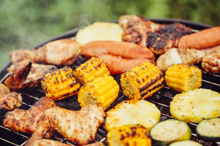 Various meats and vegetables on the grill