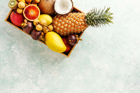 A box of fresh Thai fruit. Top view. Food background with copy space.