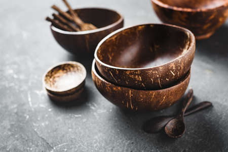 Tableware made of coconut and palm wood. Selective focus.