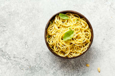 Spaghetti with pesto. The view from the top. Copy space