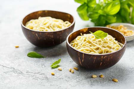 Spaghetti with pesto in coconut bowls, Organic food. Reklamní fotografie
